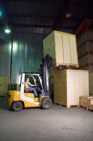 work load: Man working on the truck in the warehouse