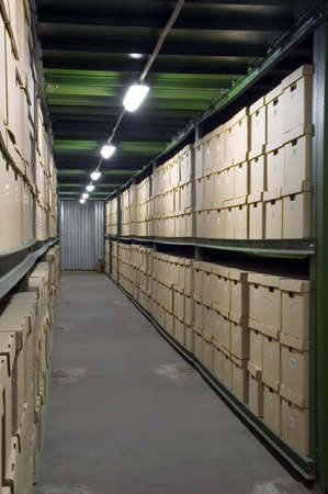 Cardboard boxes on the shelves in the warehouse photo