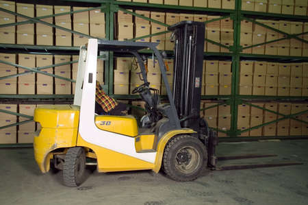 Truck in the warehouse. Boxes on the shelves in the background. Stock Photo