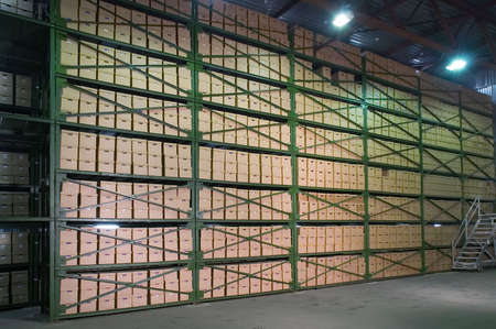 stash: Cardboard boxes on the shelves in the warehouse