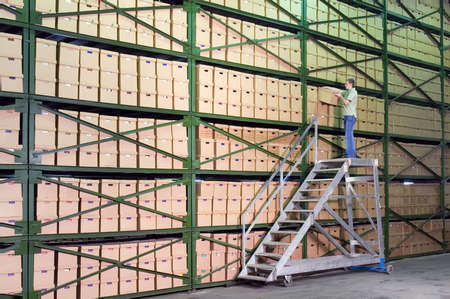 depository: Man working on the stairs in the warehouse Stock Photo