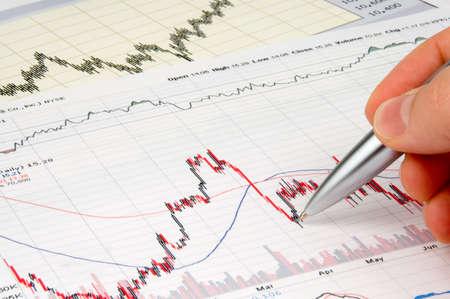 Pen showing diagram on financial reportmagazine Stock Photo