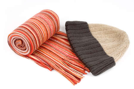 tog: Tortile multicolor wool scarf and cap over white background