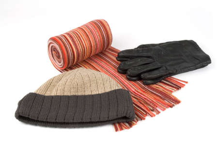 Tortile multicolor wool scarf, cap ang black gloves  over white background