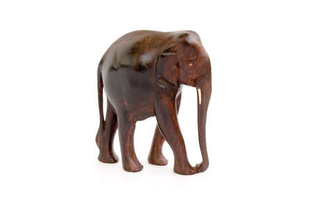 Wooden carving elephant toy isolated over white background photo
