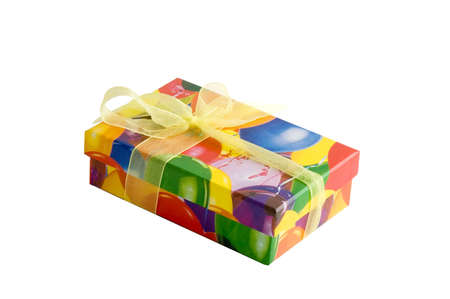 Multicolored gift box wih yellow bow isolated over white photo
