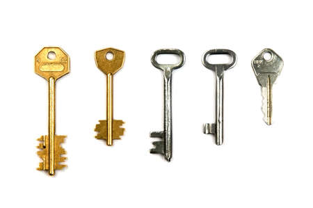 Five different steel keys isolated over white
