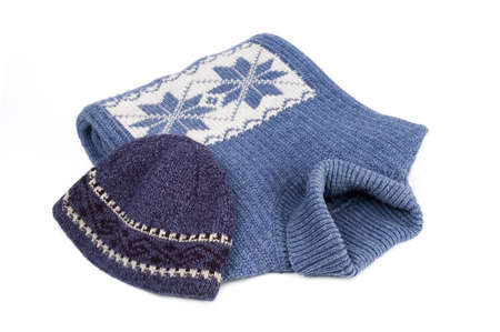 winter blues: Winter blue sweater and cap with  ornament isolated over white