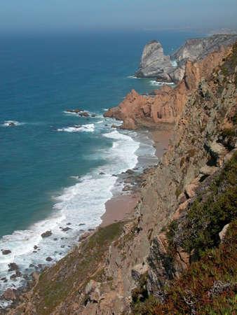 The Atlantic Ocean rocky coast in the summer. photo