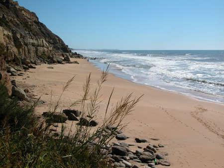 The Atlantic ocean rocky coast. Sandy beach. photo