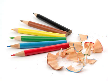 Six  coloured pencils and chip isolated over white background