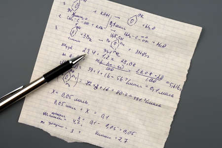 Copy-book sheet of paper with formulas and pen isolated over gray Stock Photo - 846539
