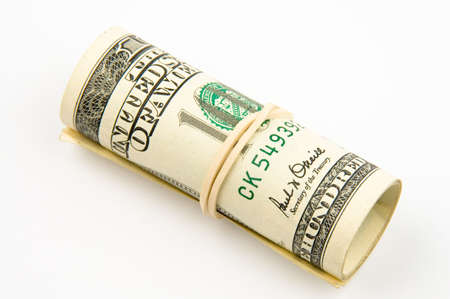 convolute: One hundred dollars banknotes convolute to the roll Stock Photo