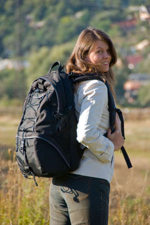 Portrait of young woman with black backpack Stock Photo