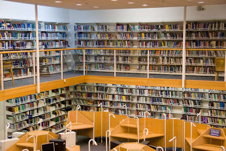data dictionary: Modern library interior, a lot of books on the bookshelfs