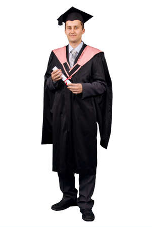 baccalaureate: Young man dressed in black graduation gown holding certificate of degree. Isolated over white background.