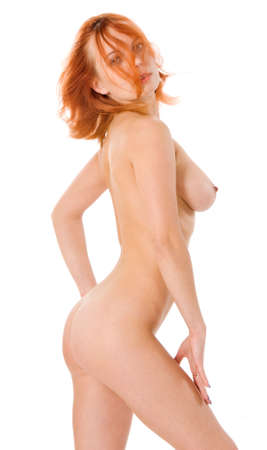 nude woman standing: Sexy naked redhead woman in studio on white