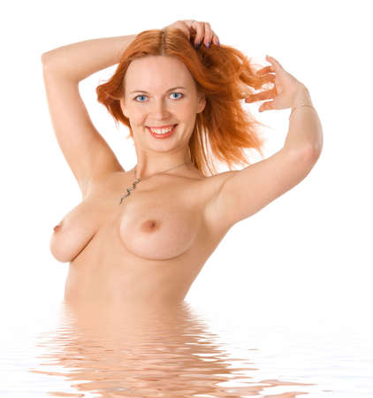 Sexy  redhead woman in water Stock Photo