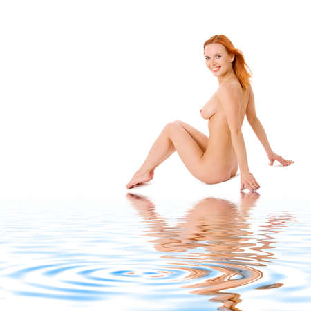 aqua naked: Lovely redhead lady sitting on white sand