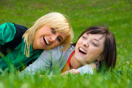 Laughing Happy blonde and brunette playing on the nature