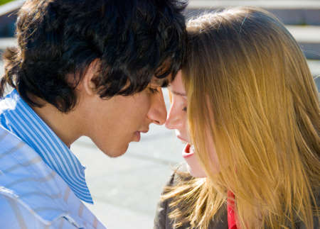 Happy teen couple in love romantic portrait photo
