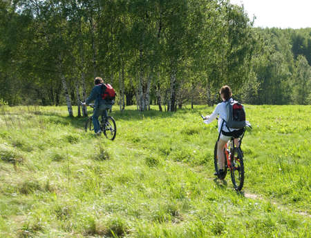 Two young cycling in a nature   photo