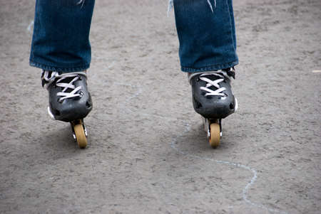 rollerskater: Roller-skater legs stand on asphalt Stock Photo