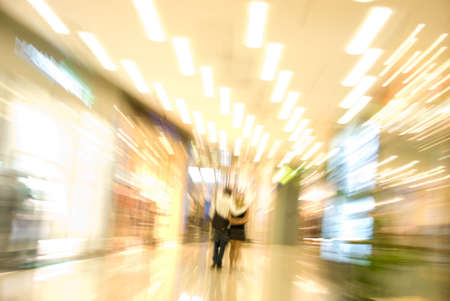 Couple in a mall. Blurred motion image Stock Photo
