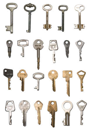 Find a right key. Isolated various metal keys over white. Use them in your own designs. Stock Photo