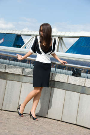 Young business woman poses outdoors photo