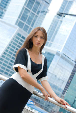 Portrait of young business woman. Modern buildings on the background. photo