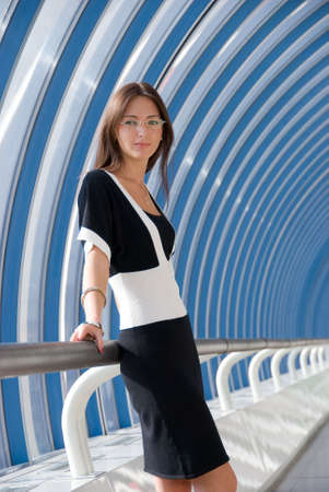 Young businesswoman poses in business center photo