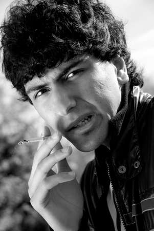 Black and white portrait of smoking arabic guy photo