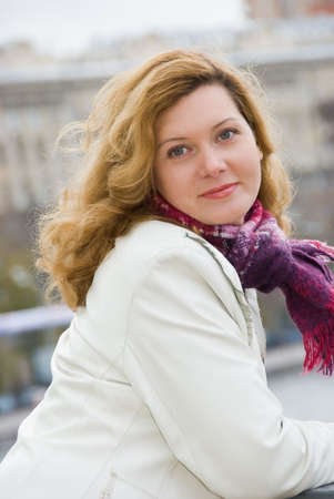 Middle age woman portrait in a city photo