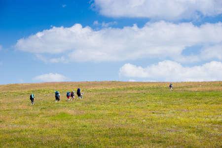 Family hikes in mountains   photo