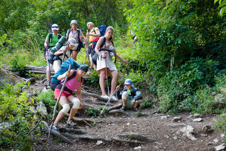 Hikers go down on a stony track photo
