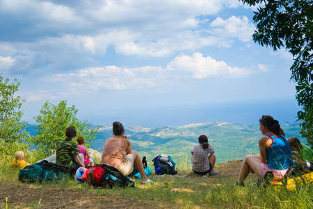 Hikers have a rest on a hillside