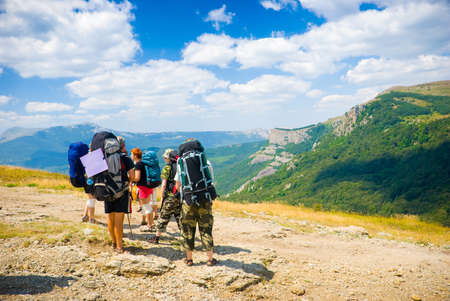 admire: Hikers admire a scenery in Crimea mountains