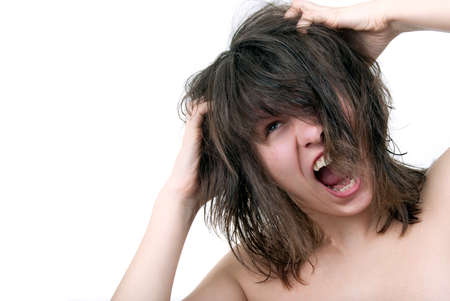 scratching head: Young woman furiously scratches her tangled hair