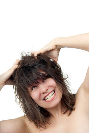 Young woman furiously scratches her tangled hair photo