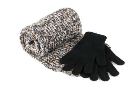Tortile multicolor wool scarf ang black gloves isolated over white background photo