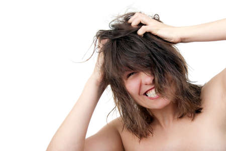 malice: Young woman furiously scratches her tangled hair