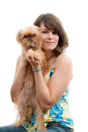 Young woman with dog on her knees. Breed - Griffon Bruxellois. Stock Photo - 4474188