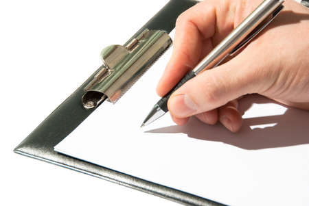 subscribing: Pen in a hand ready for writing on a paper in clipboard