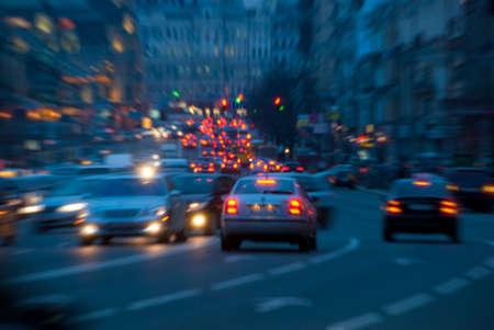 car lights: Urban night traffic, blurred with zoom effect