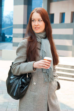 Business woman with coffee on a street photo
