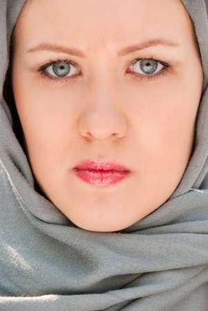Serious muslim woman close-up portrait photo