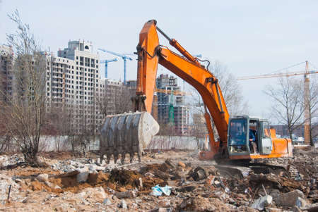mine site: Excavator works in a construction site Stock Photo