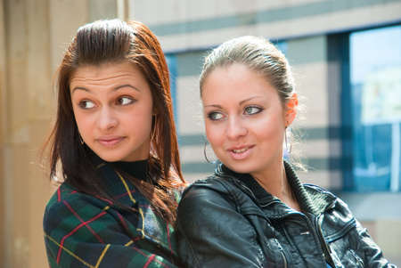Two young beautiful girls in a city Stock Photo - 4906030