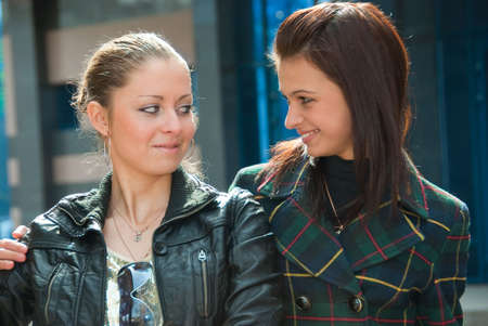 lesbian love: Two young beautiful girls in a city Stock Photo